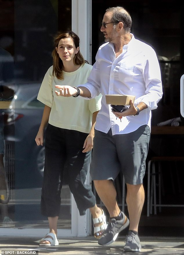 Chic look: She sported a chic oversized pastel yellow t-shirt by Acne Studios, which draped loosely over her slim figure