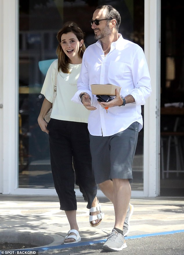 Open-toe: She paired the top with some black pleated capri pants and some white open-toe Birkenstocks, which matched her fresh white pedicure
