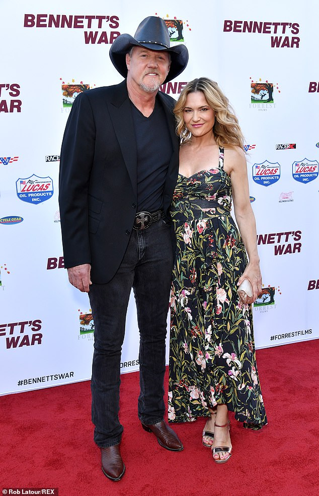 Dating: Adkins's girlfriend Victoria Pratt opted for a floral print sleeveless dress and silver sandal heels