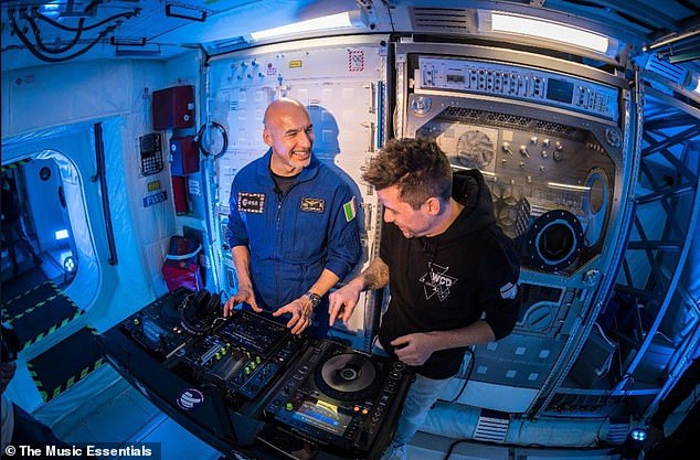 Crash course: Ahead of his DJ set, Parmitano was given a crash course on the decks by German DJ, Le Shuuk, real name Chris Stritzel, who previously took part in a zero gravity flight