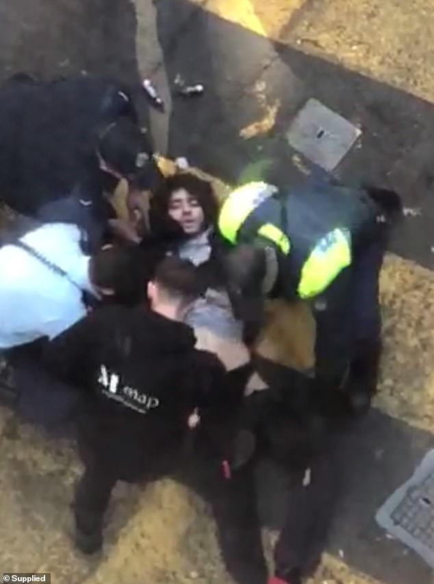 Alleged attacker Mert Ney is believed to have acted at random, and is expected to be charged. He is seen being restrained by witnesses and police