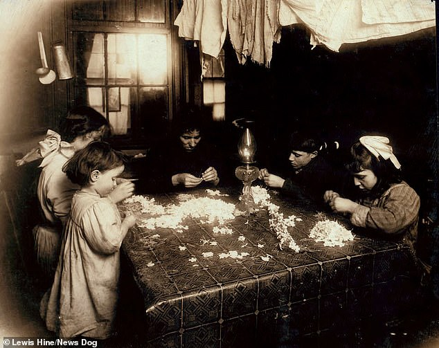 The Mortaria family make flowers and wreaths in their tenement in New York. The three-year-old (near left) will work until 8pm. The other children work until 10pm. It wasn't until 1938 that Americans earned a national minimum wage and restrictions on child labour were enforced