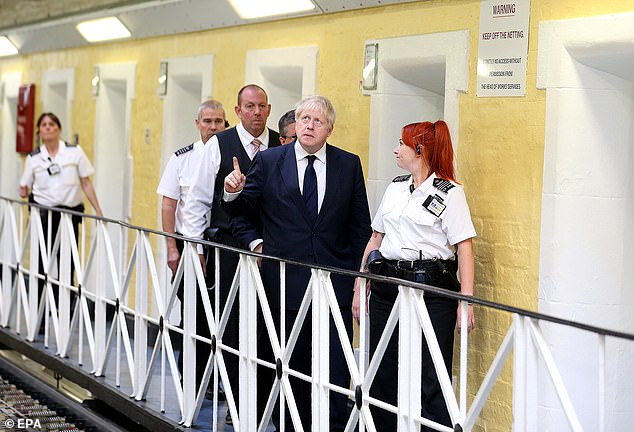 Mr Johnson, pictured today during a visit to HMP Leeds, predicted a US-UK trade deal will be a 'tough old haggle'