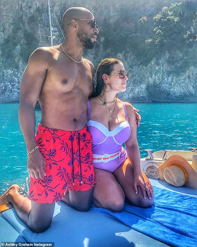 Fashionista: Ashley hid her growing bump on vacation with a perfectly placed thick white belt that goes with her classic lavender swimsuit