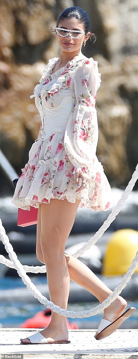 Summer loving: Kylie looked sensational in her floral bustier dress which had frilly sections and cinched her in at the waist