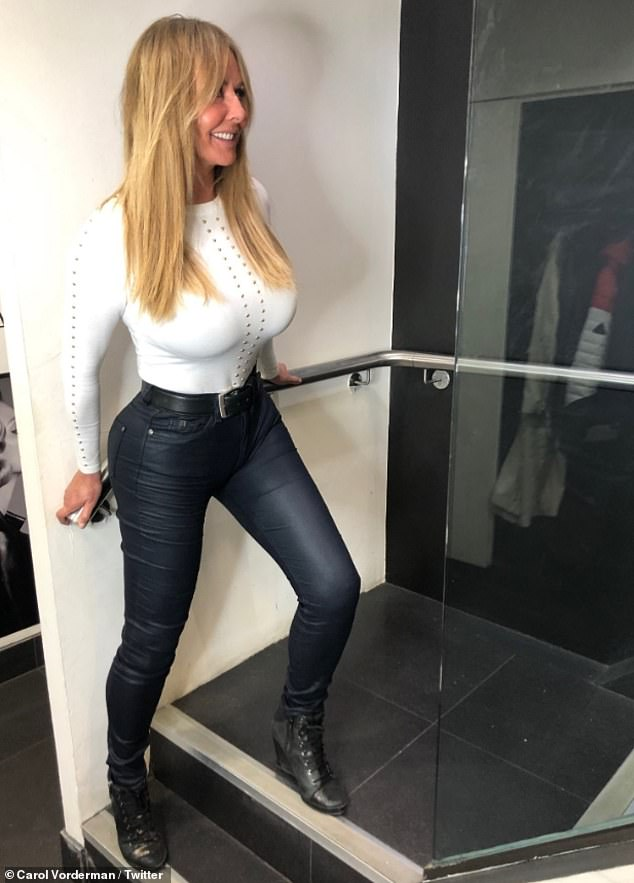 Distractions: Squeezing her hourglass figure into the sexy outfit, fans didn't know where to look as her famous derriere and ample assets took centre stage