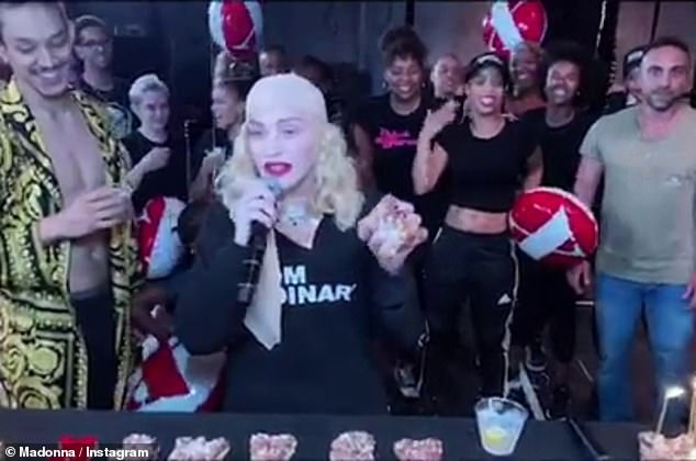 Dig in:'This is the beginning of three marvelous nights of celebration, and it all starts with donuts,' Madonna said, wearing a black t-shirt and a beige bandanna on her head