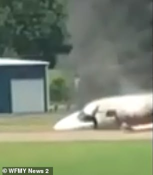 In the video obtained by WFMY, a slightly dazed Earnhardt Jr can be seen emerging from the cabin door and turning around to clutch baby Isla in his arms, before sprinting from the wreckage