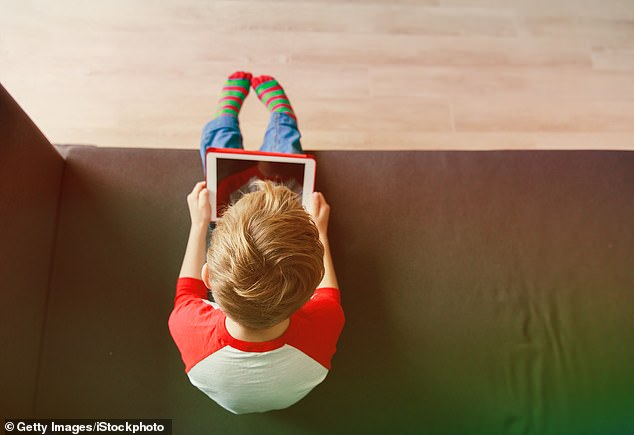 Researchers recommend that parents and carers monitor their children's screen time and make sure they are being physically active and get enough sleep (stock image)