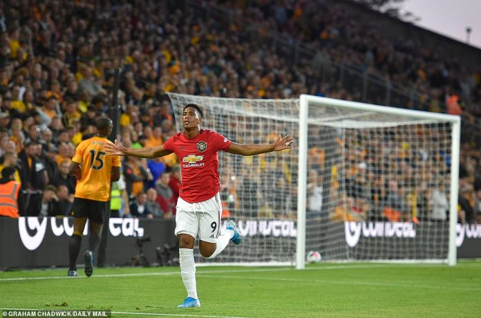 Martial wheels off to celebrate after giving the Red Devils lift-off against Nuno Espirito Santo's outfit on Monday