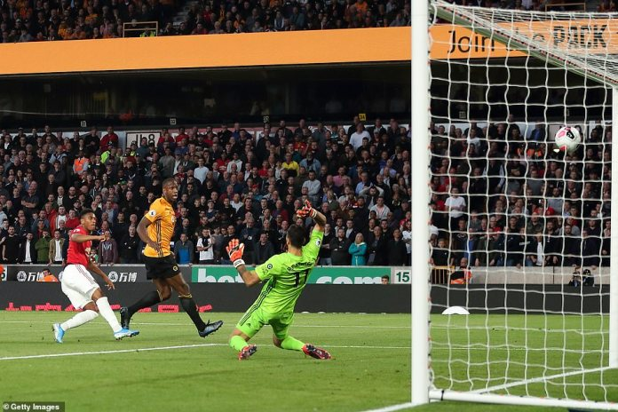 The 23-year-old pictured smashing his fierce left-footed effort into the roof of the Wolves net past goalkeeper Patricio
