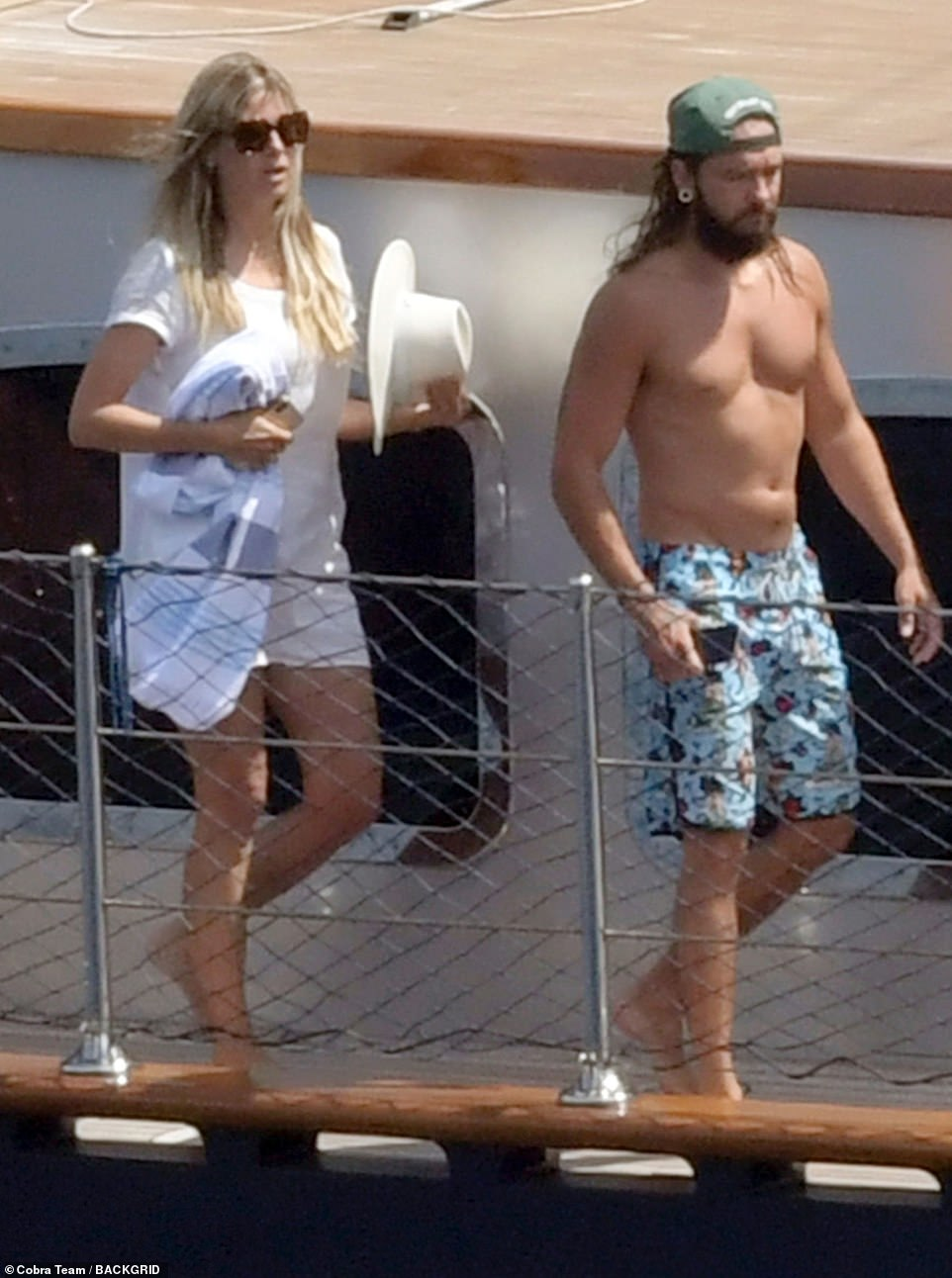 Catwalk ready: Heidi put on a very leggy display as she walked behind her man on deck