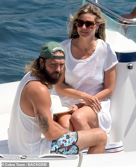 Close: Heidi and Tom, who crossed paths on the set of Germany's Next Top Model, sparked dating rumours after they were spotted kissing on the set of America's Got Talent