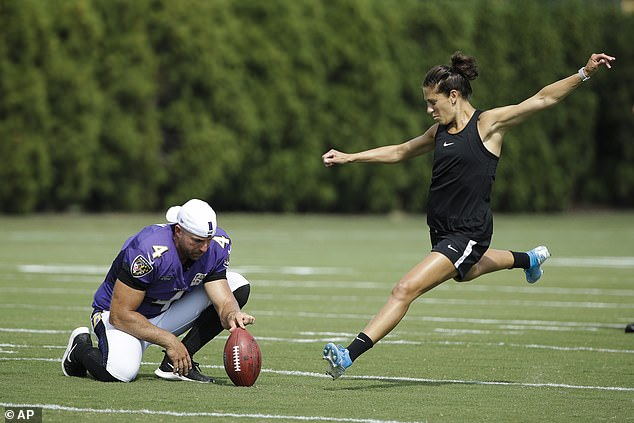 While she was kicking at the Eagles' facility, the team was hosting a joint practice with the Ravens, which is why veteran Baltimore punter Sam Koch can be seen holding for Lloyd as she made her 55-yard attempt