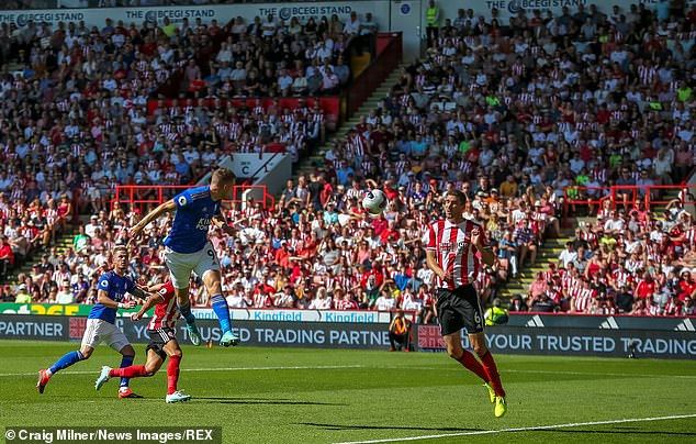 Leicester forward, Vardy, fires a header across the penalty area but it is dealt with by the hosts