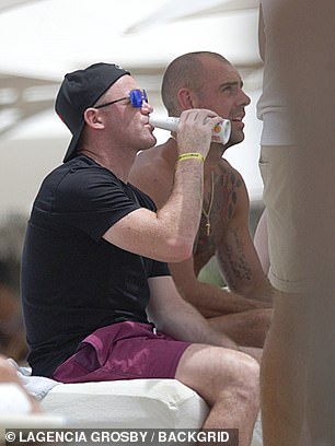 Rooney enjoy sun and drinks in a beach club in Ibiza in 2017