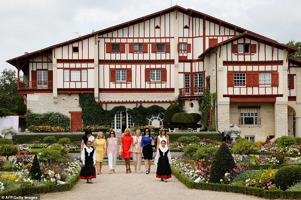 The seven women pose in front of the Villa Arnaga in Cambo-les-Bains during the geopolitical meet-up in the south of France