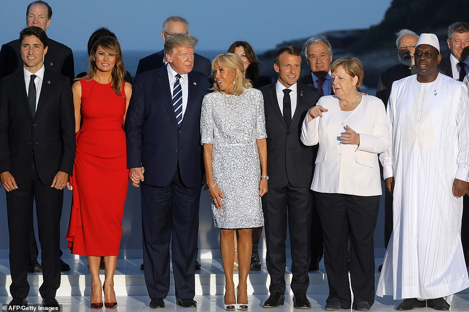 The G7 group appeared in high spirits as they posed for photos ahead of their second dinner of the summit. From left to right are:Canada's Prime Minister Justin Trudeau, Melania Trump, Donald Trump, French First Lady Brigitte Macron, French President Emmanuel Macron, Germany's Chancellor Angela Merkel and Senegal's President Macky Sall