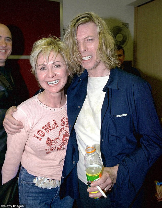 Close: Lulu is also known for her brief fling with David Bowie. In 2019 she revealed she was in love with him in the seventies (pictured in 2000)