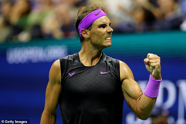Nadal flexes his muscles as he celebrates winning a point during his late night match