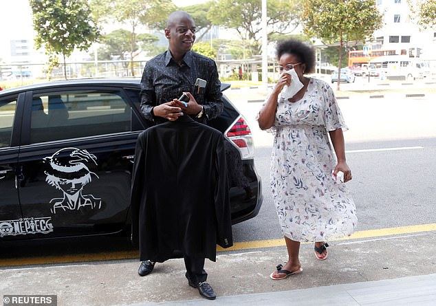 Adam Molai, who is married to Mr Robert Mugabe's niece Sandra Mugabe arrive at funeral parlour in Singapore. Preparations have begun to give Robert Mugabe a state funeral