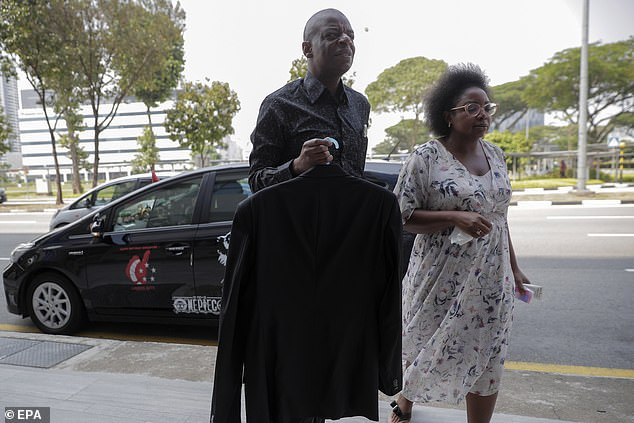Mr Molai and Robert Mugabe's niece Sandra arrive at the Singapore Casket building, where the body of former Zimbabwe President Robert Mugabe is being held