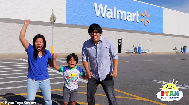 Walmart is selling action figures in Ryan's likeness, with his face on the packaging and other toys under the Ryan's World brand. Ryan is pictured with his parents,Shion and Loann