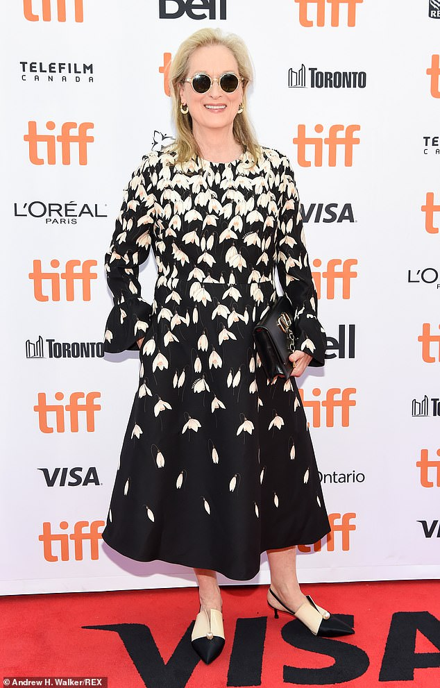Eye-catching: Streep, 70, made a stylish entrance in a black dress dotted with white and yellow flowers and two-tone slingbacks