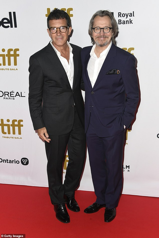 No tie: Antonio Banderas and Gary Oldman pull off the no-tie look at the TIFF Tribute Gala
