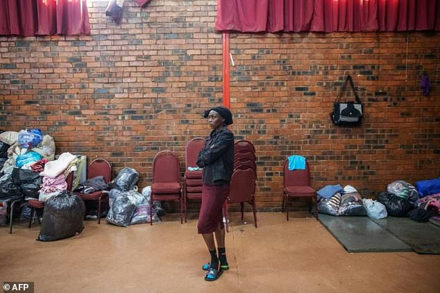 Shelter: Hundreds of foreigners have sought refuge in community halls