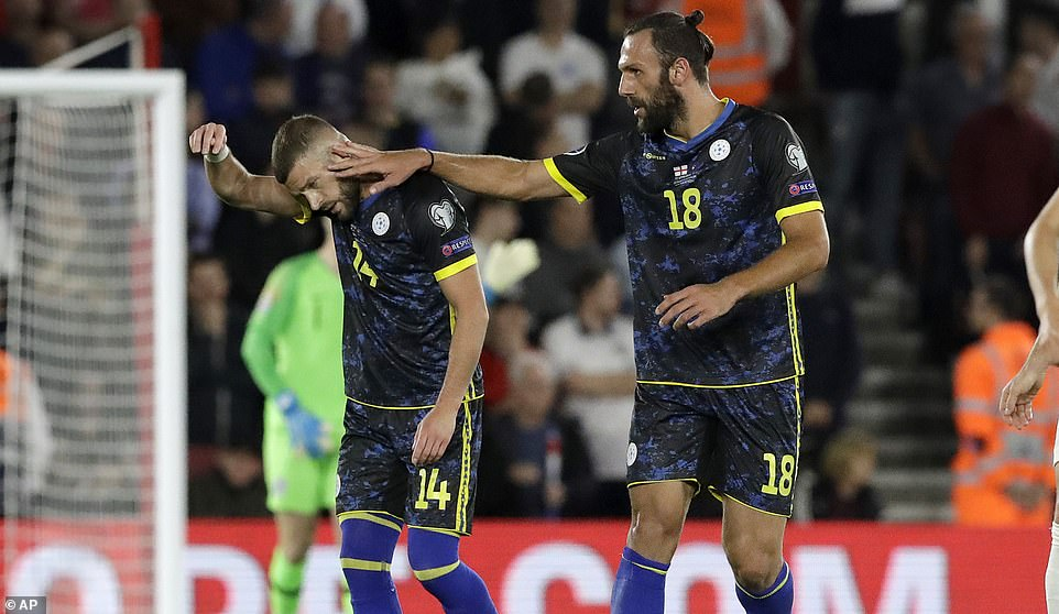 Muriqi (right) celebrates with Berisha after Kosovo managed to get their third goal of the game against England