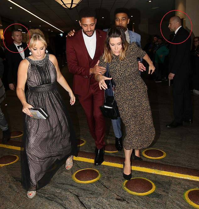 Leaving: Security were seen near Asan as he left the hotel with his co-star Jay Kontzle