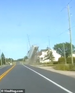 This sudden impact sends the trailer flying into the air, landing in the roof