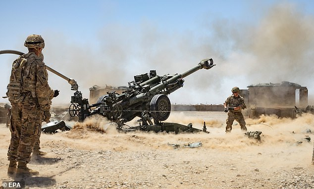 A handout photo made available by the US Army shows Soldiers from the 1-118th Field Artillery Regiment of the 48th Infantry Brigade Combat Team firing an M777 Howitzer during a fire mission in Helmand Province, southern Afghanistan, 10 June 2019