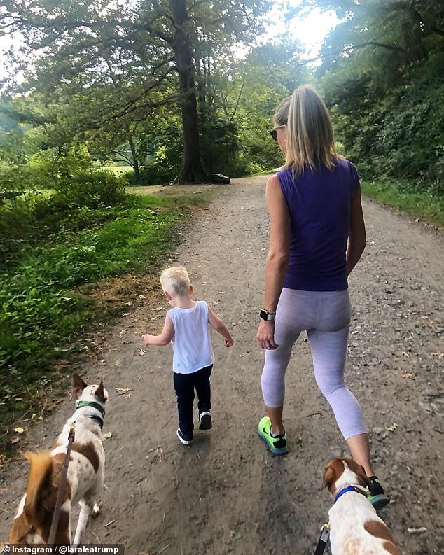 Active: The next day, Lara posted snapshots of herself enjoying a nature walk with her son, Luke, and their dogs Charlie and Ben