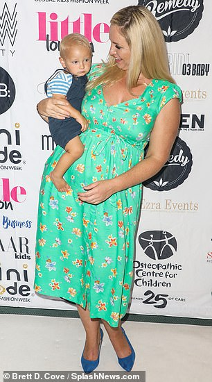Stylish: The former Big Brother star, 34, looked radiant in a green floral maxi-dress which had a sweetheart neckline