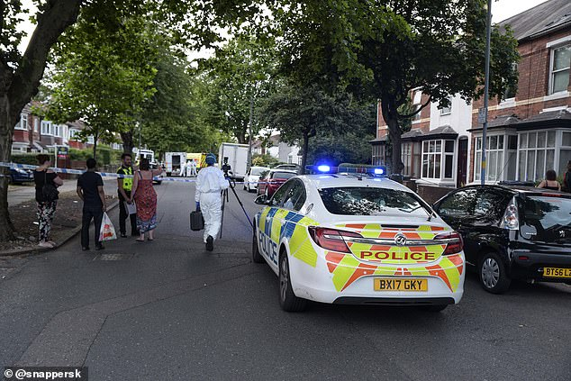 Emergency services and forensics officers are on scene the drive-by shooting