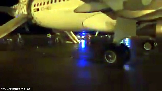 Several people can be seen standing on the tarmac after getting off the plane at midnight on Friday. PassengerJavier Calderon saidcrew appeared to be acting without any protocols