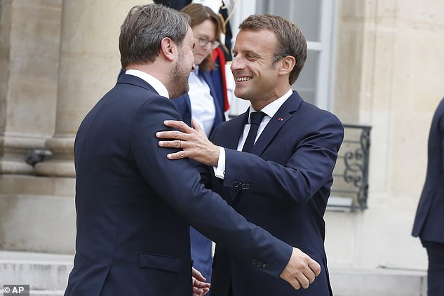 Mr Bettel and Mr Johnson's meeting appeared to be cordial enough but the Luxembourg PM seemed much happier today in Paris as he was given a pat on the back by Emmanuel Macron as they met for talks