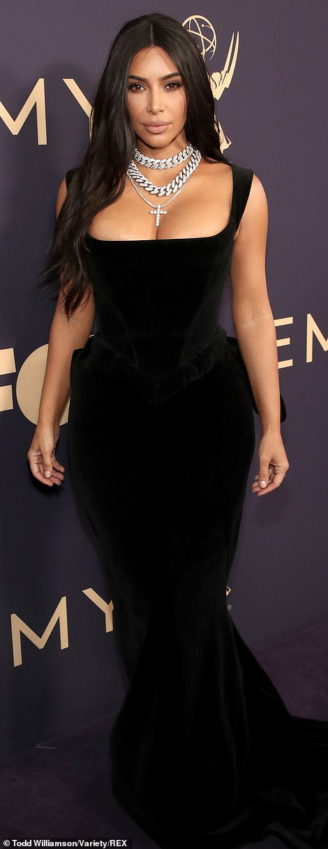 Dangerous curves ahead! Kim's dress fit her famously curvy figure like a glove