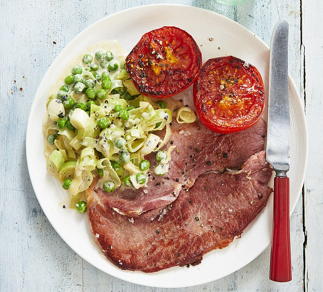 Gammon with creamy leeks, peas and grilled tomato