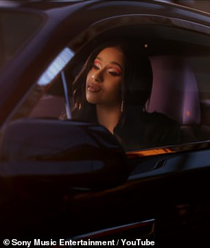 Cardi in the car:The video cuts between scenes of Cardi driving in a car, fleeing from police, and of her hanging out with French Montana and others of her reflecting on her reflection