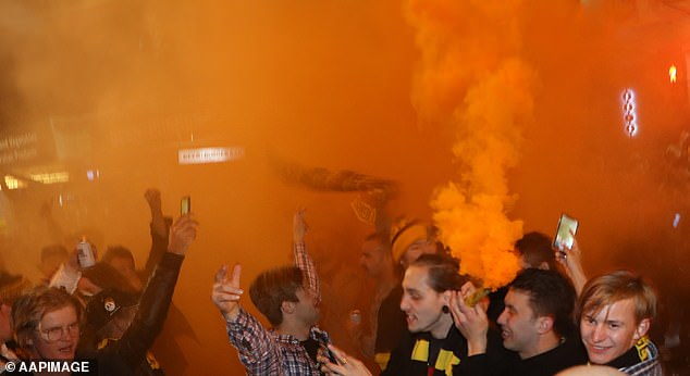 Flares were set off in the crowded Richmond precinct as thousands of fans celebrated the win
