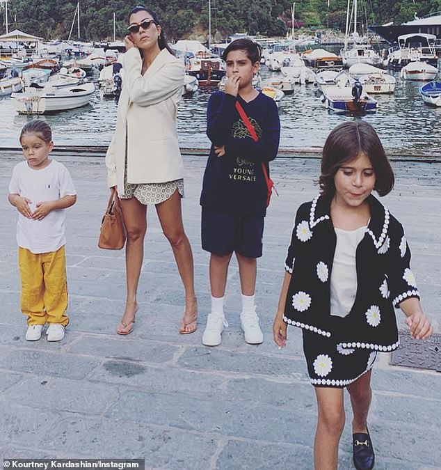 Family matters:Kourtney shares three children - Mason, nine, Penelope, seven, and Reign, four - with her dashing ex Scott Disick, 36