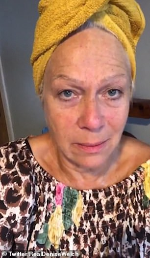 'The unwelcome visitor': She was makeup-free and wore a yellow towel wrapped around her head
