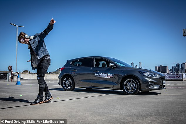 Donning distorting goggles while a wearing 'drunk suit' (pictured) shows young drivers how difficult it is to walk a straight line after several standard drinks