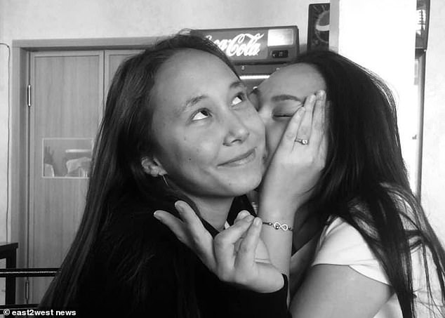 Alua Abzalbek, pictured with a friend, died when her phone overheated while charging, according to forensic experts