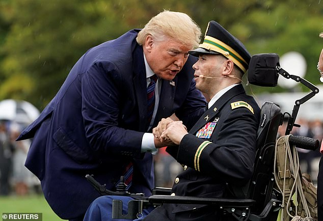Donald Trump embraced a wounded and wheel-chair bound veteran from Afghanistan who sang 'God Bless America'