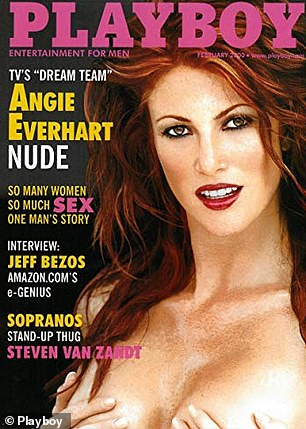 Posing on the cover of Playboy, Angie Everhart holds her augmented breasts