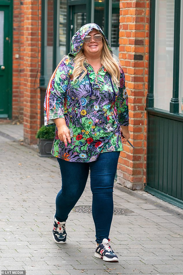 There she is! Gemma Collins, 38, continued to show off her slimmer figure as she stepped out in rainy Brentwood, Essex on Tuesday